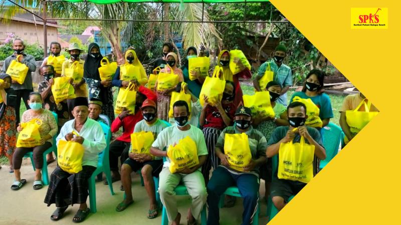 Peringati Hari Tani Nasional 2021, SPKS Salurkan Bantuan ke Ribuan Petani Sawit Kecil